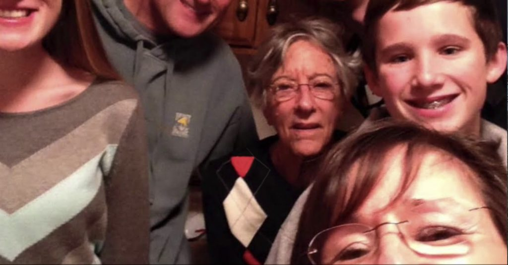 Southern Pines Senior Living Video Thumbnail Family Group Surrounded by senior living resident